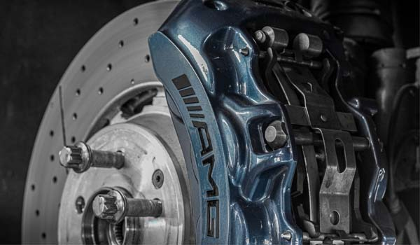 blue AMG caliper and silver slotted brake disc