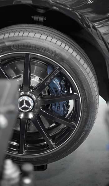 black mercedes wheel with a blue brake caliper